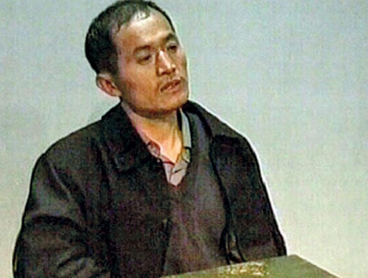 Yang Xinhai, multiple serial killer from China, after his arrest